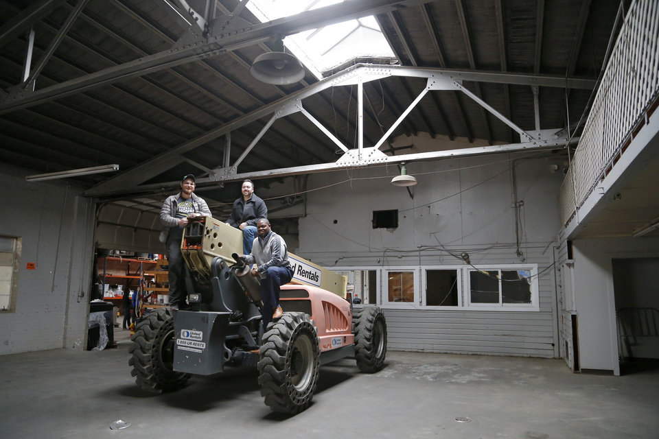 Photo -  From left Evan Smith, Andrew Carrales and Nicholas White share laughs inside the warehouse at 118 NW 8 that will be home to their Vanessa House brewery. [Photo by Sarah Phipps, The Oklahoman]
