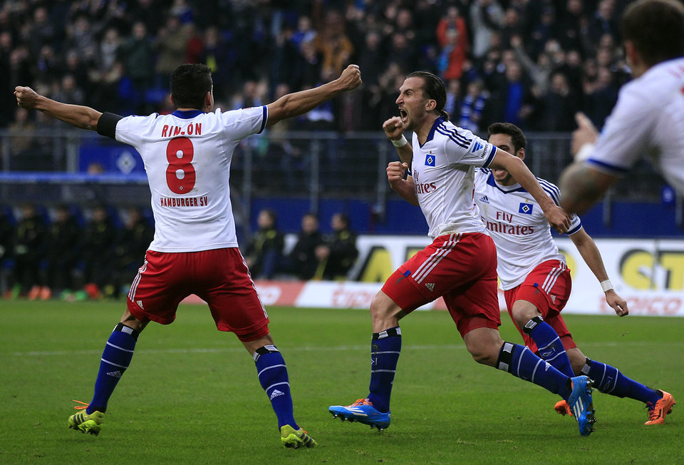 Photo - Hamburg's Petr Jiracek of Czech Republic, center, celebrates after scoring during the German first division Bundesliga soccer match between Hamburg SV and BvB Borussia Dortmund in Hamburg, Germany, Saturday, Feb. 22, 2014. (AP Photo/Frank Augstein)