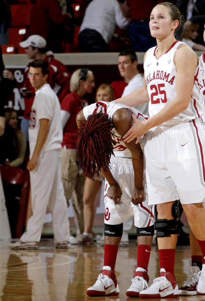 Photo - OU's Danielle Robinson (13) and OU's Whitney Hand (25) reacts after OU's loss in the Big 12 women's basketball game between the University of Oklahoma and Texas A&M at Lloyd Noble Center in Norman, Okla., Wednesday January 26, 2011.  Photo by Bryan Terry, The Oklahoman