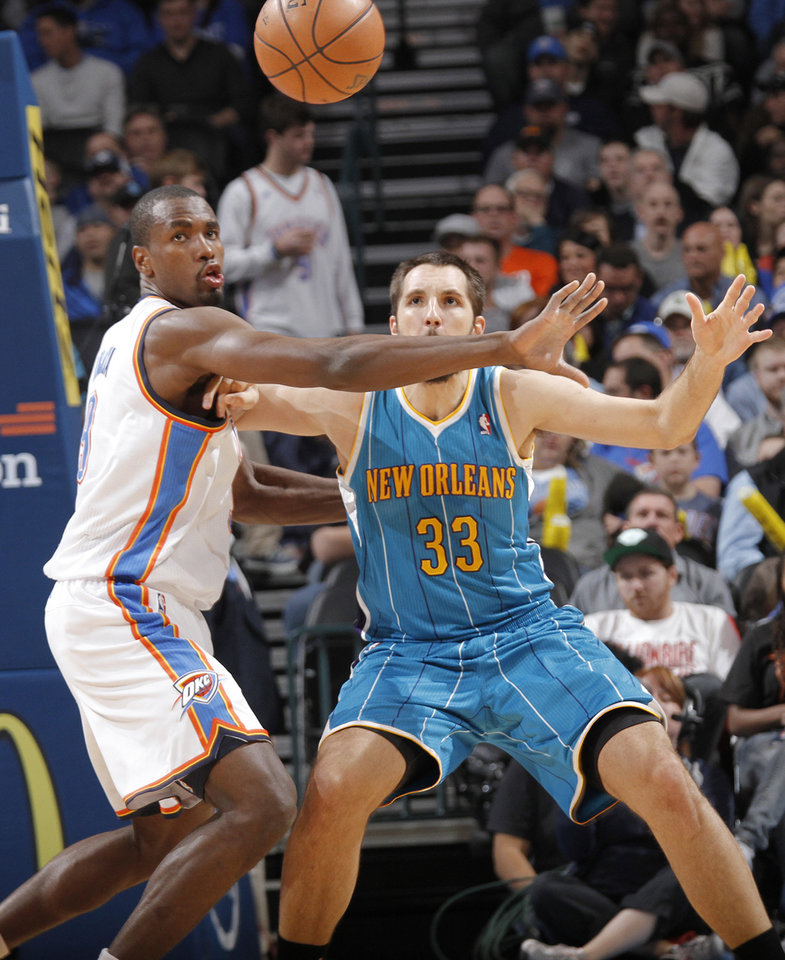 Oklahoma City Thunder's Serge Ibaka (9) defends on New Orleans Hornets' Ryan Anderson (33) during the NBA basketball game between the Oklahoma CIty Thunder and the New Orleans Hornets at the Chesapeake Energy Arena on Wednesday, Dec. 12, 2012, in Oklahoma City, Okla.   Photo by Chris Landsberger, The Oklahoman