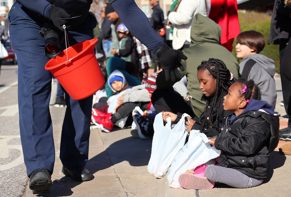Photo - Children long the parade route waiting for candy at the MLK Day Parade during celebration of Dr. Martin Luther King, Jr. holiday, Monday, January 20, 2019. [Photo by Doug Hoke/The Oklahoman]