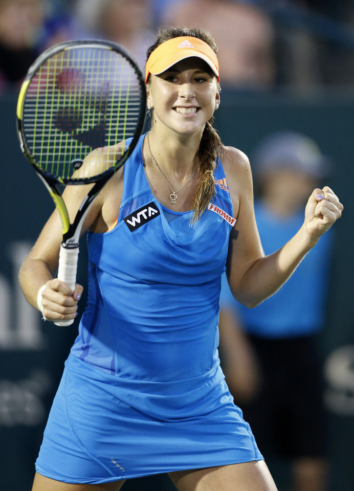 Photo - Belinda Bencic, of Switzerland, reacts to defeating Sara Errani, of Italy, in three sets during the Family Circle Cup tennis tournament in Charleston, S.C., Friday, April 4, 2014. (AP Photo/Mic Smith)