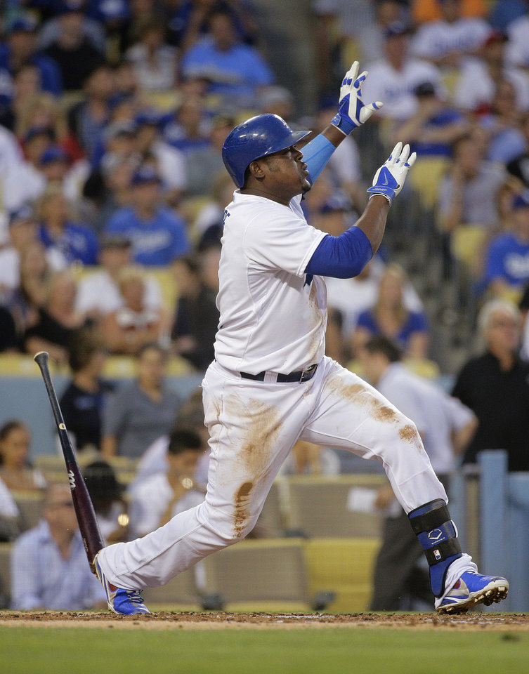 Photo - Los Angeles Dodgers' Juan Uribe watches the flight of his three-run home run during the second inning of a baseball game against the Los Angeles Angels on Tuesday, Aug. 5, 2014, in Los Angeles. (AP Photo/Jae C. Hong)