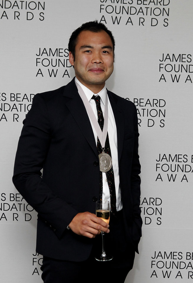 Photo -   Chef Paul Qui poses with his medal for Best Chef: Southeast, during the James Beard Foundation Awards, Monday, May 7, 2012, in New York. (AP Photo/Jason DeCrow)