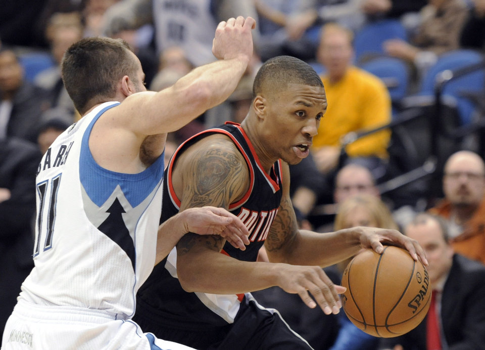 Portland Trail Blazers' Damian Lillard drives to the basket against Minnesota Timberwolves' J.J. Barea (11) during the fourth quarter of an NBA basketball game Monday, Feb. 4, 2013, in Minneapolis. The Trail Blazers won 100-98. (AP Photo/Hannah Foslien)