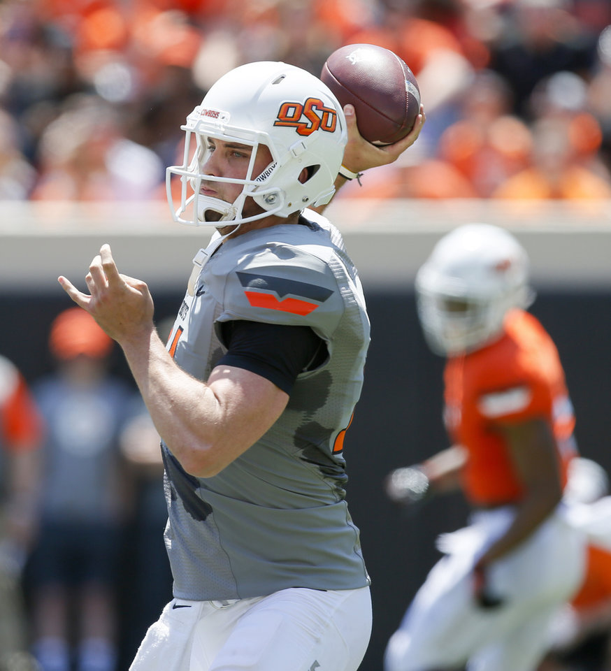 Photo - Taylor Cornelius (14) passes during the spring football game for the Oklahoma State Cowboys (OSU) at Boone Pickens Stadium in Stillwater, Okla., Saturday, April 28, 2018. Photo by Nate Billings, The Oklahoman