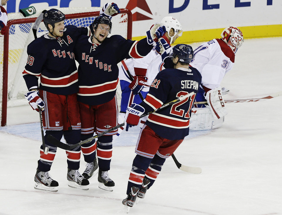 Photo - New York Rangers' Anton Stralman, of Sweden, second from left, celebrates with Marc Staal, left, and Derek Stepan (21) as Montreal Canadiens goalie Carey Price, right, reacts after Stralman scored during the second period of an NHL hockey game, Tuesday, Feb. 19, 2013, in New York. (AP Photo/Frank Franklin II)