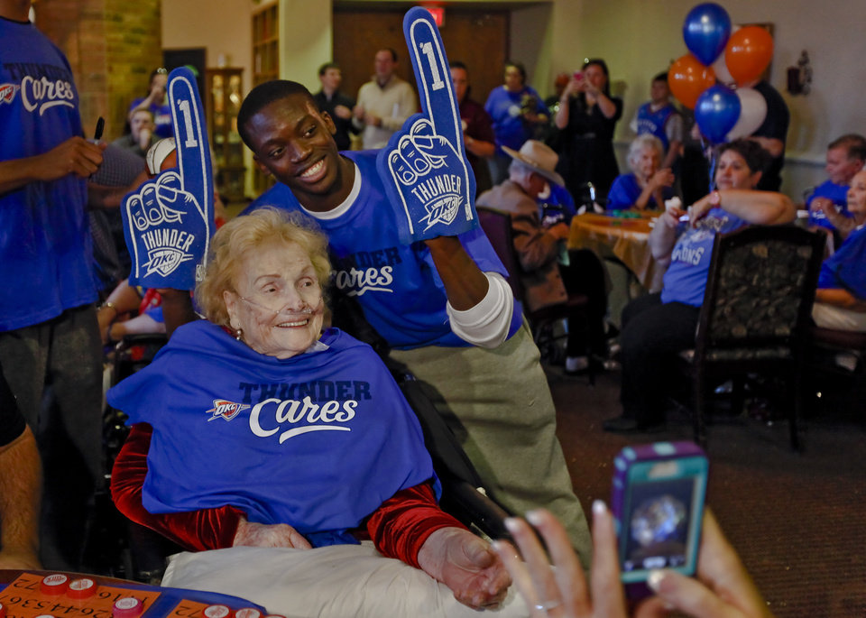 Reggie Jackson poses for a photo with bingo winner Helen LaRue during the Oklahoma City Thunder's 1000th community appearance at Ranchwood Nursing Home on Tuesday, Nov. 27, 2012, in Yukon, Okla.   Photo by Chris Landsberger, The Oklahoman
