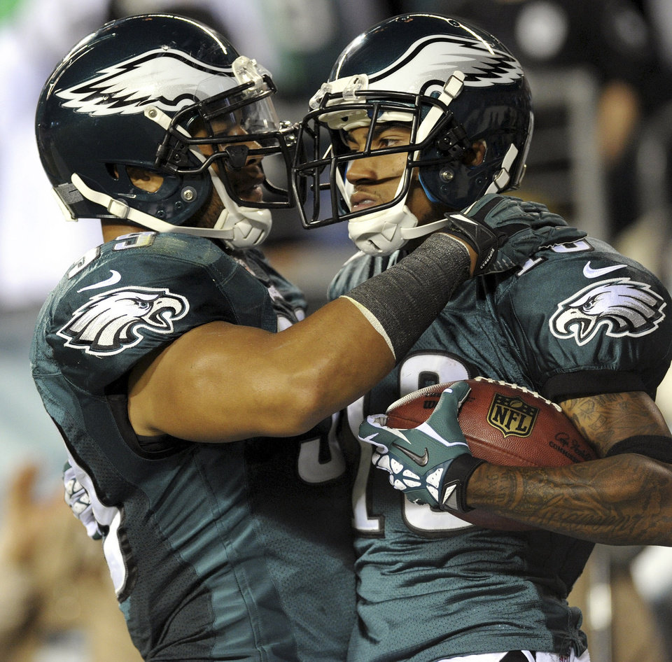 Philadelphia Eagles fullback Stanley Havili, left, congratulates wide receiver DeSean Jackson, right, after Jackson scored a touchdown against the New York Giants during their NFL football game, Sunday, Sept. 30, 2012, in Philadelphia. The Eagles won 19-17. (AP Photo/The Express-Times, Matt Smith)
