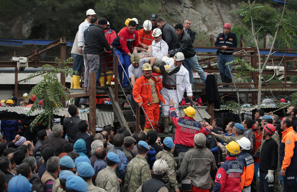 Photo - Rescue workers carry a rescued miner from the mine in Soma, western Turkey, early Wednesday, May 14, 2014. Rescuers desperately raced against time to reach more than 200 miners trapped underground Wednesday after an explosion and fire at a coal mine in western Turkey killed at least 205 workers, authorities said, in one of the worst mining disasters in Turkish history. Turkey's Energy Minister Taner Yildiz said 787 people were inside the coal mine in Soma, some 250 kilometers (155 miles) south of Istanbul, at the time of the accident and 363 of them had been rescued so far. (AP Photo/Emrah Gurel)