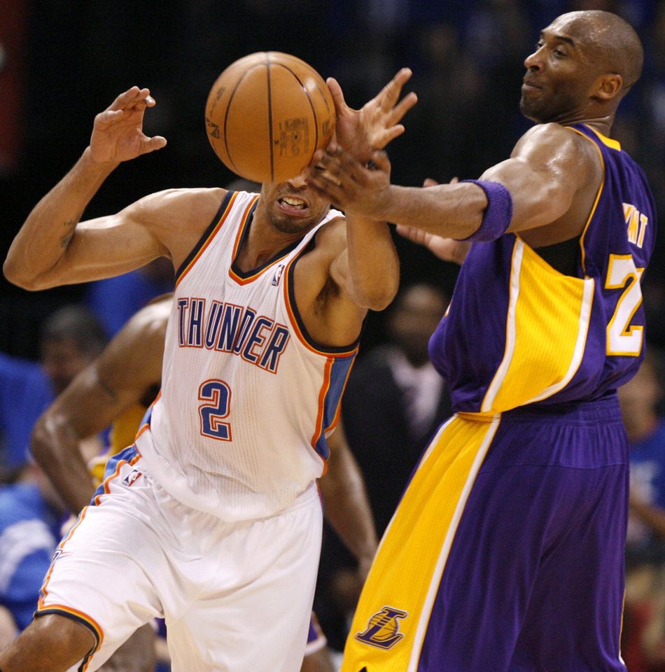 Oklahoma City's Thabo Sefolosha (2) tries to take the ball away from Los Angeles' Kobe Bryant (24) during Game 1 in the second round of the NBA playoffs between the Oklahoma City Thunder and L.A. Lakers at Chesapeake Energy Arena in Oklahoma City, Monday, May 14, 2012. Oklahoma City won 119-90. Photo by Bryan Terry, The Oklahoman
