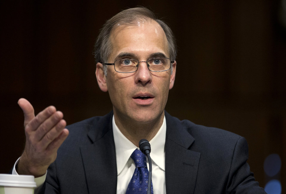 Photo - Mark Zandi, chief economist at Moodys Analytics, gestures as he testifies on Capitol Hill in Washington, Thursday, Dec. 6, 2012, before the Joint Economic Committee hearing entitled: