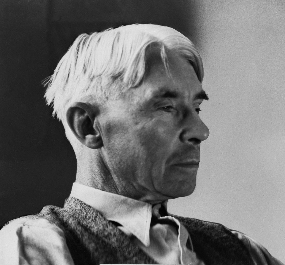 Photo - In this undated file photo American writer and poet Carl Sandburg poses for a photo. Poets and writers on both sides of the Atlantic at first cheered on the battles of World War I. Carl Sandburg's