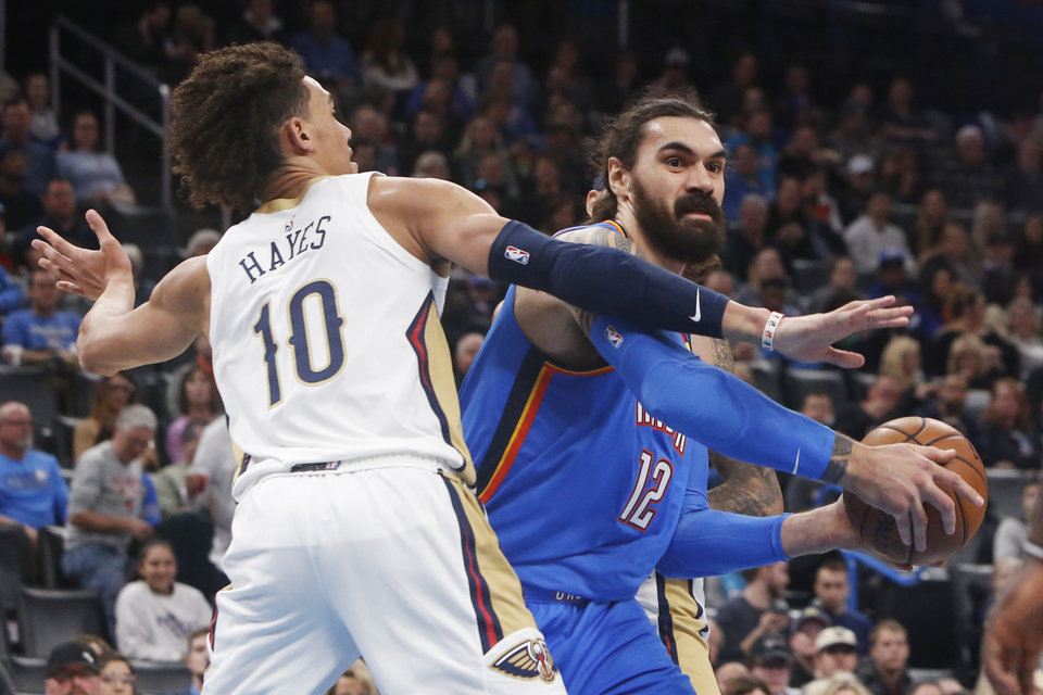 Photo - Oklahoma City Thunder center Steven Adams (12) looks to pass around New Orleans Pelicans center Jaxson Hayes (10) during the first half of an NBA basketball game Friday, Nov. 29, 2019, in Oklahoma City. [AP Photo/Sue Ogrocki]