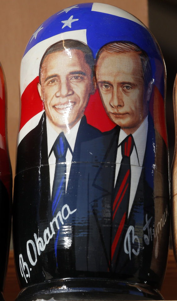 Photo - CORRECTS SPELLING OF MATRYOSHKA  A traditional Russian  Matryoshka  wooden doll depicting US President Barack Obama and Russian President Vladimir Putin, on a display in St. Petersburg, Russia, Friday, Sept. 6, 2013.  St. Petersburg is currently hosting the G-20 summit of world leaders .  (AP Photo/Dmitry Lovetsky)