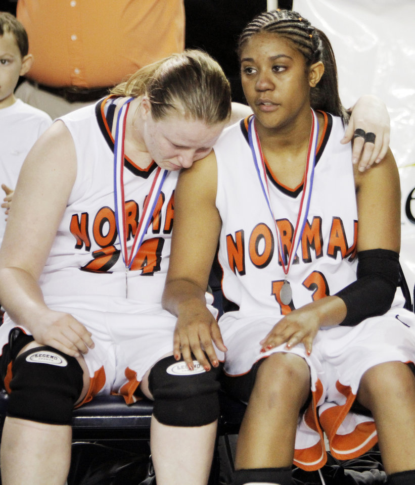 Photo - Norman's Olivia Meek (24), left, and Kim Hayes (13) sit together after the Lady Tigers lost in the Class 6A girls high school basketball state tournament final between Midwest City and Norman at the ORU Mabee Center in Tulsa, Okla., Saturday, March 13, 2010. Midwest City won, 46-32. Photo by Nate Billings, The Oklahoman