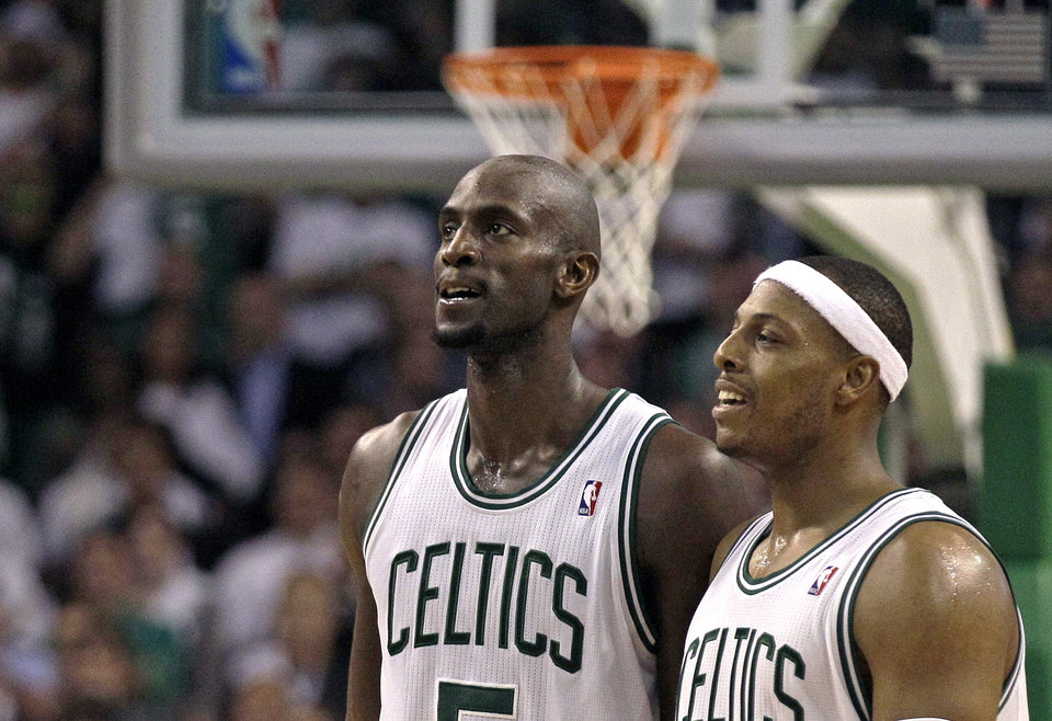 Photo -   Boston Celtics power forward Kevin Garnett, left, and teammate Paul Pierce walk up court against the Atlanta Hawks during Game 3 of an NBA first-round playoff basketball series Friday, May 4, 2012, in Boston. The Celtics beat the Hawks 90-84, leading the series 2-1. (AP Photo/Charles Krupa)