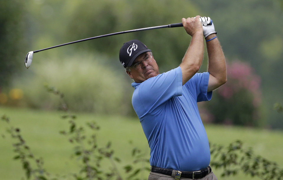 Photo - Kenny Perry watches his tee shot on the ninth hole during the third round of the PGA Championship golf tournament at Valhalla Golf Club on Saturday, Aug. 9, 2014, in Louisville, Ky. (AP Photo/David J. Phillip)