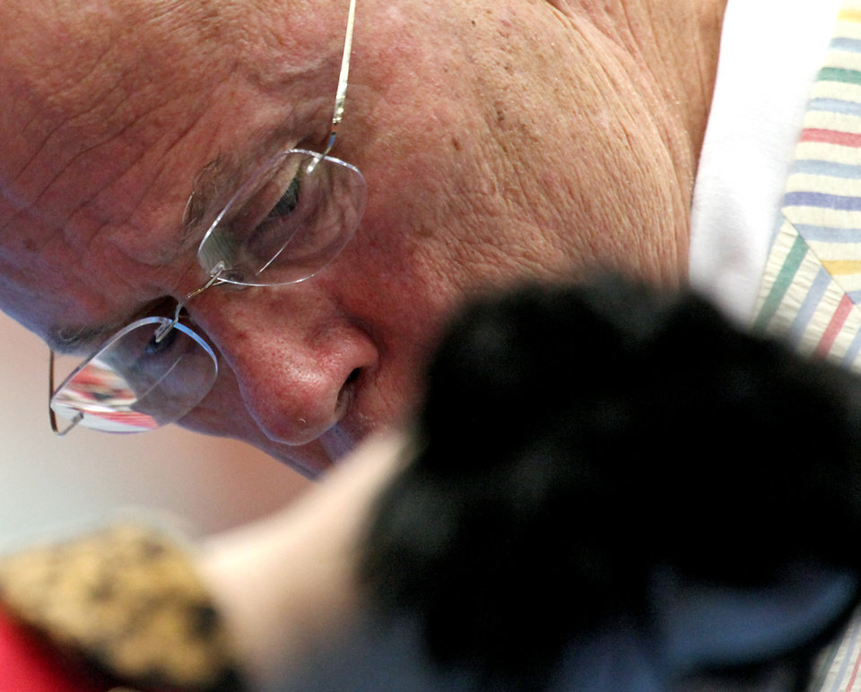 Judge Edd Biven (CQ) EDD BIVEN looks over a dog  during the Oklahoma City Summer Classic Dog Show at the Cox Convention Center in Oklahoma City Sunday, June 28, 2009. Photo by John Clanton, The Oklahoman
