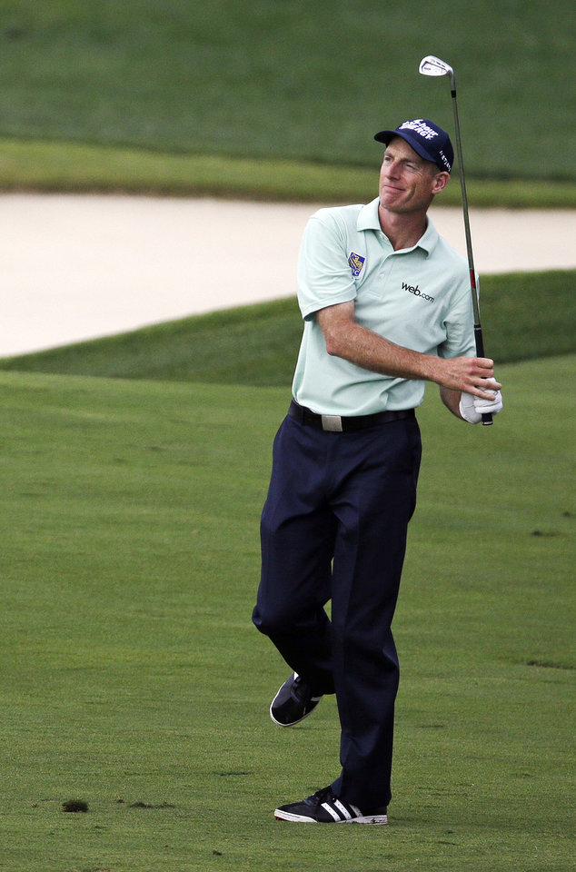 Photo - Jim Furyk watches his shot on the ninth hole during the second round of the PGA Championship golf tournament at Valhalla Golf Club on Friday, Aug. 8, 2014, in Louisville, Ky. (AP Photo/John Locher)