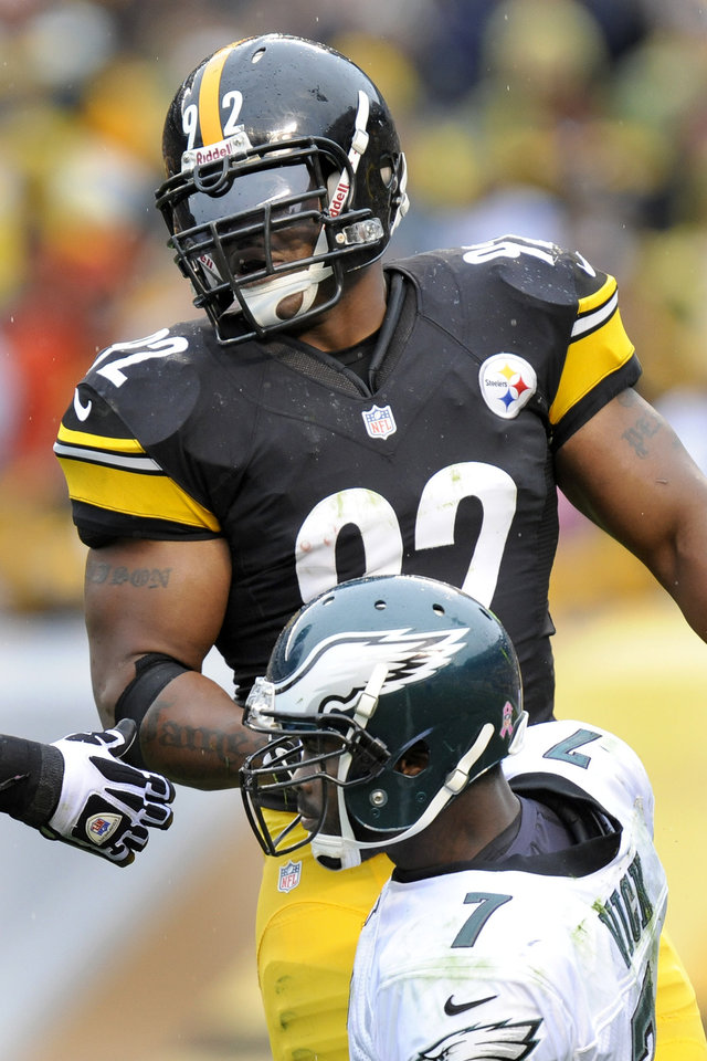 Pittsburgh Steelers linebacker James Harrison (92) helps up Philadelphia Eagles quarterback Michael Vick (7) in the third quarter of an NFL football game on Sunday, Oct. 7, 2012, in Pittsburgh. This was Harrison's first game of the season after coming back from knee surgery. The Steelers won 16-14. (AP Photo/Don Wright)