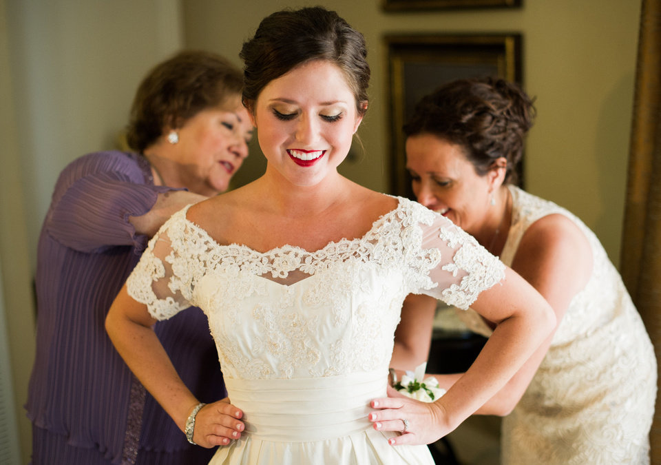 Three generations of women all wore the same wedding gown to their weddings. Shown from left are Yolanda Holliger, Katy Elder and Rose Costello. Photo by Beautiful Day Images. <strong></strong>