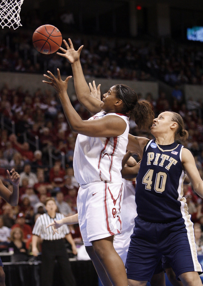 Courtney Paris rebounds in front of Pepper Wilson (40) in the second half of the NCAA women's basketball tournament game between the University of Oklahoma and Pittsburgh at the Ford Center in Oklahoma City, Okla. on Sunday, March 29, 2009. 