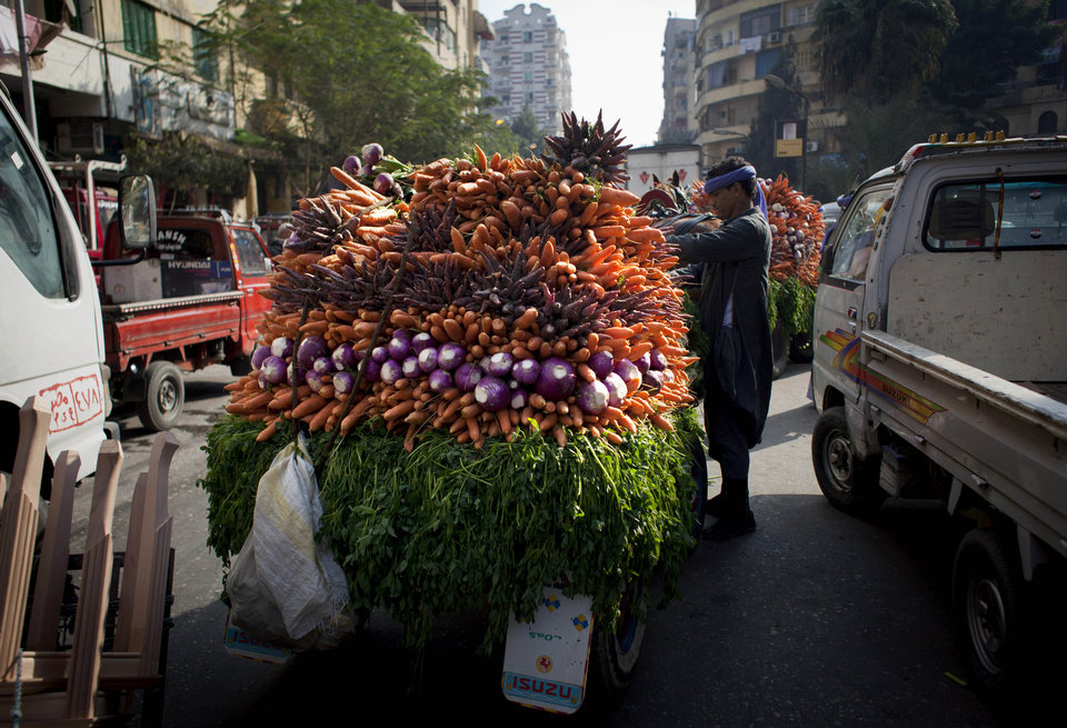 Photo - An Egyptian street vendor displays vegetables that are loaded on a cart for sale, in Cairo, Egypt, Thursday, Jan. 3, 2013. (AP Photo/Nasser Nasser)