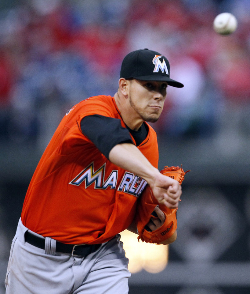 Photo - Miami Marlins' Jose Fernandez delivers a pitch during the first inning of a baseball game against the Philadelphia Phillies, Friday, April 11, 2014, in Philadelphia. (AP Photo/Tom Mihalek)