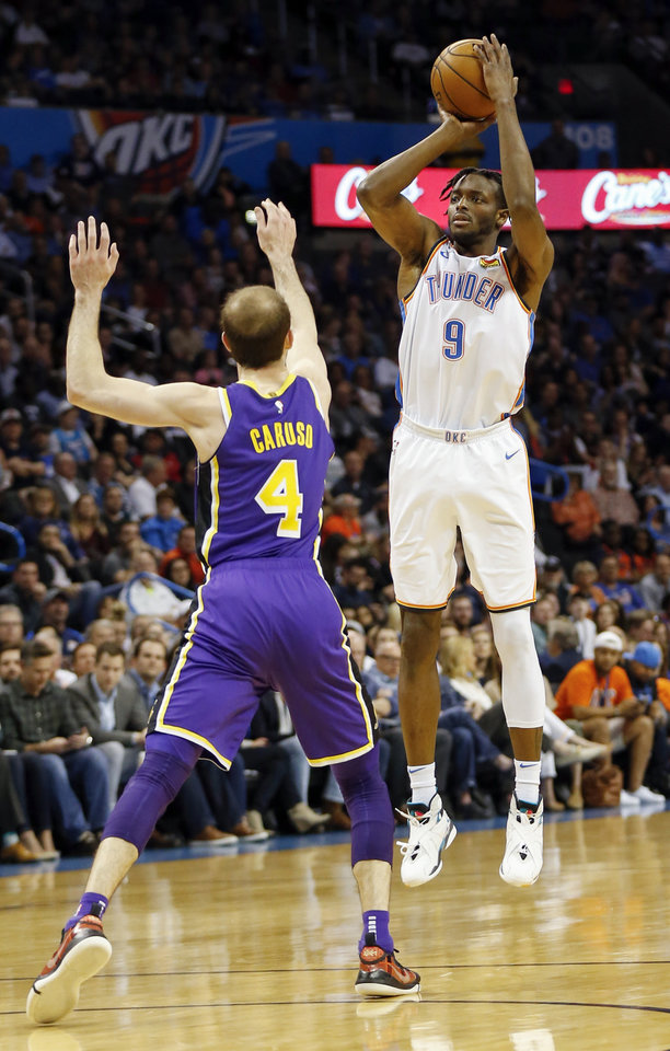 Photo - Oklahoma City's Jerami Grant (9) shoots over Los Angeles' Alex Caruso (4) during an NBA basketball game between the Los Angeles Lakers and the Oklahoma City Thunder at Chesapeake Energy Arena in Oklahoma City, Tuesday, April 2, 2019. Photo by Nate Billings, The Oklahoman