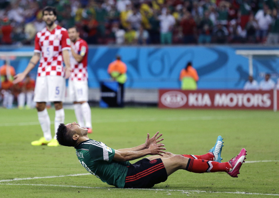 Mexico\'s Oribe Peralta reacts after missing a chance during the group A World Cup soccer match between Croatia and Mexico at the Arena Pernambuco in Recife, Brazil, Monday, June 23, 2014. (AP Photo/Sergei Grits)
