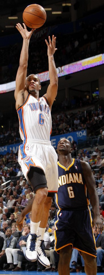 Photo - Oklahoma City's Eric Maynor (6) shoots the ball beside Indiana's Lance Stephenson (6) during the NBA basketball game between the Oklahoma City Thunder and the Indiana Pacers at the Oklahoma City Arena, Wednesday, March 2, 2011. Photo by Bryan Terry, The Oklahoman