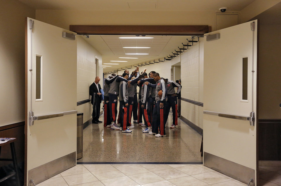 Photo - The Thunder players huddle up in the hallway before the start of Game 2 in the first round of the NBA playoffs between the Oklahoma City Thunder and the Houston Rockets at Chesapeake Energy Arena in Oklahoma City, Wednesday, April 24, 2013. Photo by Chris Landsberger, The Oklahoman