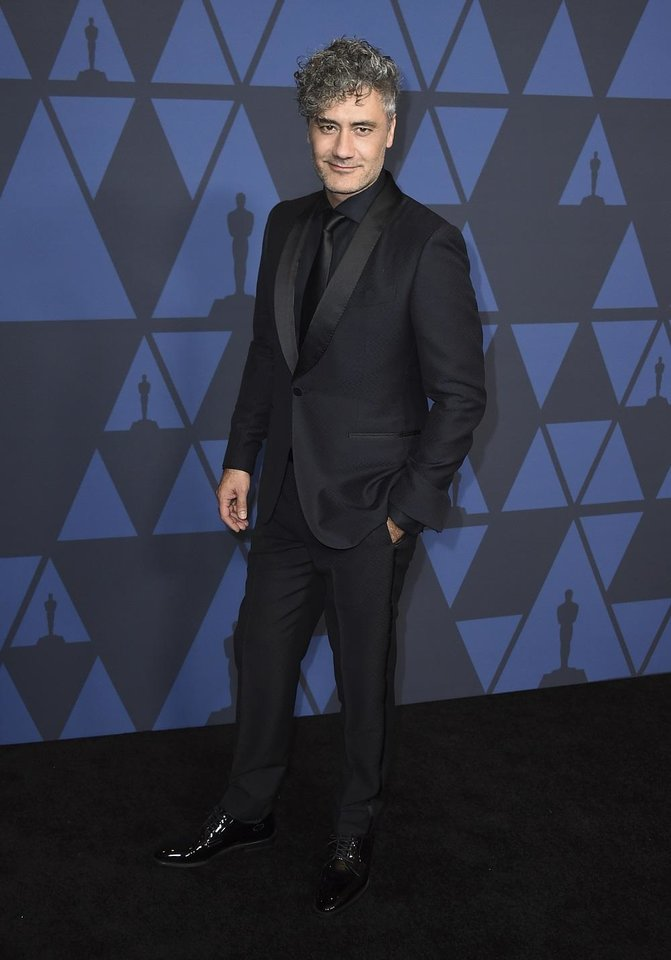 Photo - Taika Waititi arrives at the Governors Awards on Sunday, Oct. 27, 2019, at the Dolby Ballroom in Los Angeles. [Photo by Jordan Strauss/Invision/AP]