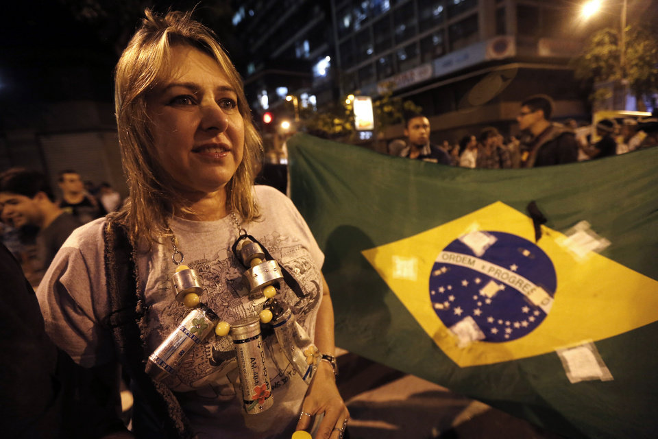 Photo - A demonstrator wears a necklace made from empty tear gas projectiles during a march in support of striking teachers, on the nation's teacher recognition day, in Rio de Janeiro, Brazil, Tuesday, Oct. 15, 2013. Teachers have been on strike demanding better pay for almost two months. (AP Photo/Silvia Izquierdo)