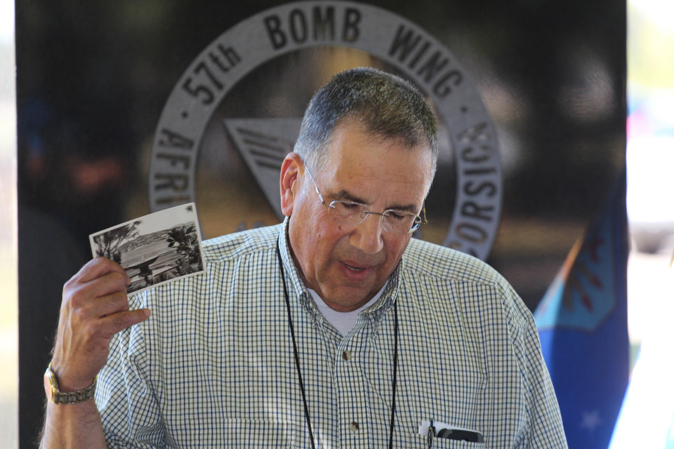 Photo - In this Sept. 27, 2013 photo, Bob Marino, whose father served in the 57th Bomb Wing, talks about his father at the memorial to the 57th Bomb Wing during a memorial ceremony at a reunion outside the U.S. Air Force Museum at Wright Patterson Air Force base in Dayton, Ohio.