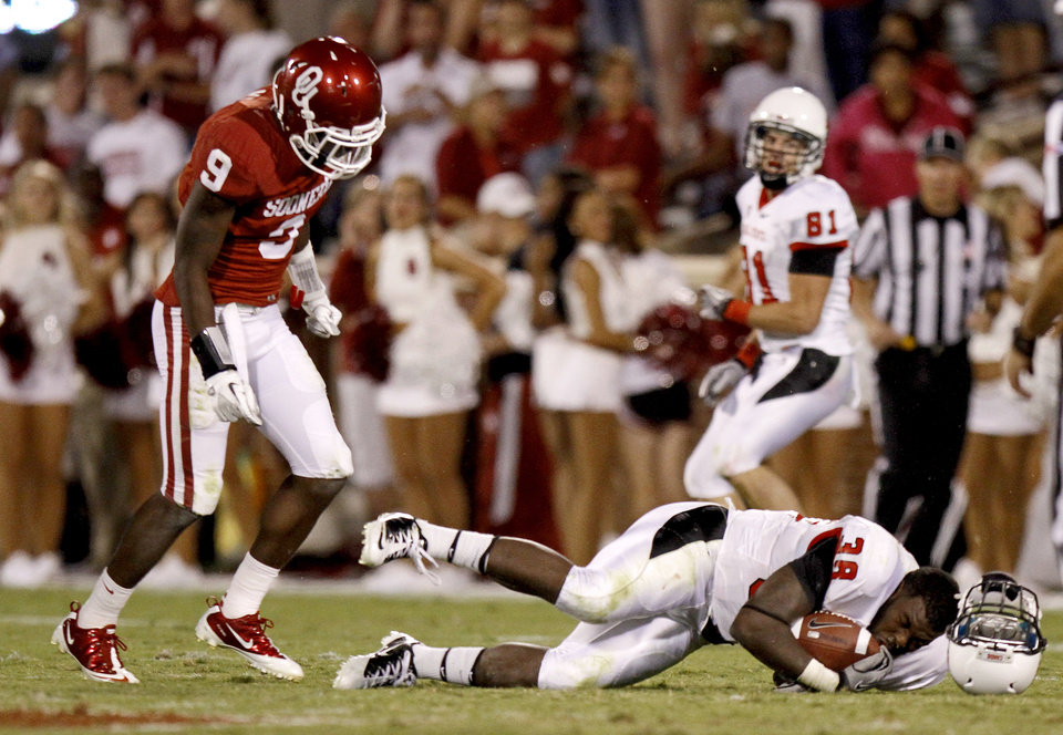 Photo - Oklahoma's Gabe Lynn (9) hits Ball State's Jahwan Edwards (38) during the college football game between the University of Oklahoma Sooners (OU) and the Ball State Cardinals at Gaylord Family-Oklahoma Memorial Stadium on Saturday, Oct. 01, 2011, in Norman, Okla. Oklahoma won 62-6. Photo by Bryan Terry, The Oklahoman  ORG XMIT: KOD
