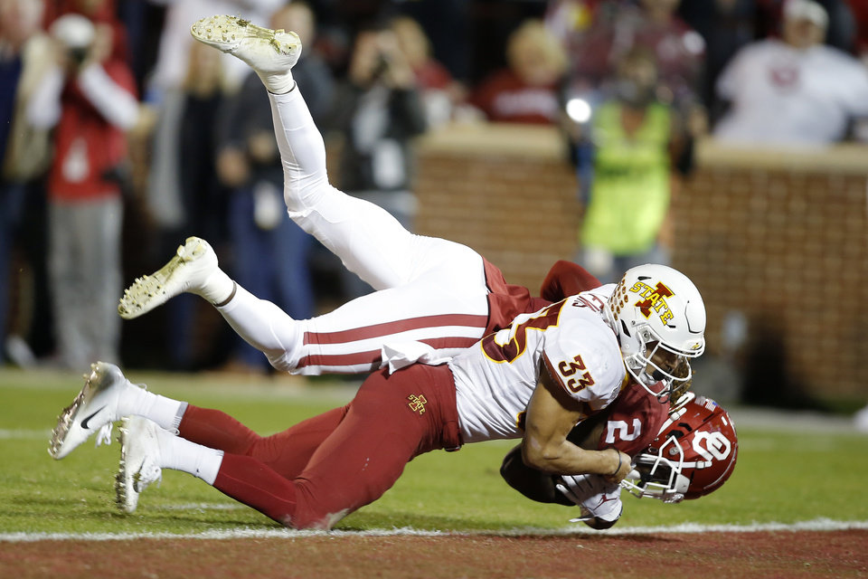 Photo - Oklahoma's CeeDee Lamb (2) scores a touchdown as he is brought down by Iowa State's Braxton Lewis (33) during an NCAA football game between the University of Oklahoma Sooners (OU) and the Iowa State University Cyclones at Gaylord Family-Oklahoma Memorial Stadium in Norman, Okla., Saturday, Nov. 9, 2019. [Bryan Terry/The Oklahoman]