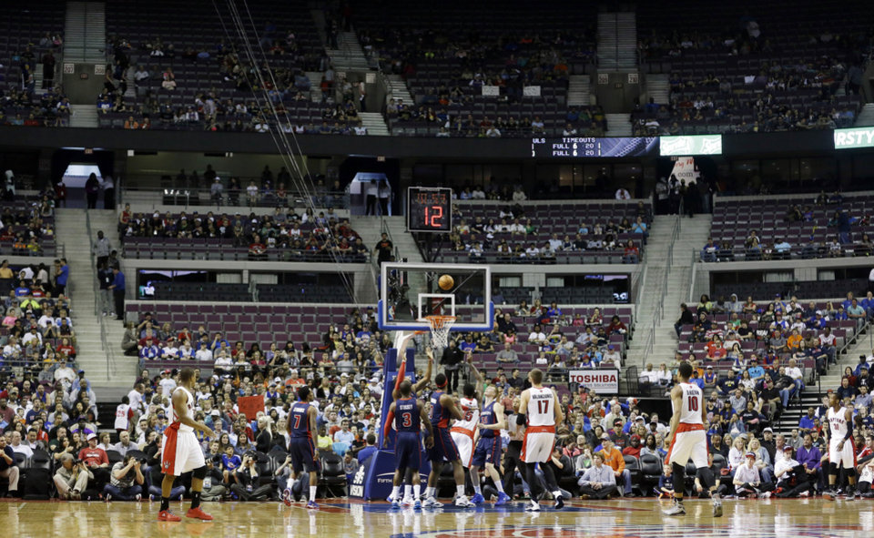 Photo - Empty seats are seen during the first half of an NBA basketball game between the Detroit Pistons and the Toronto Raptors in Auburn Hills, Mich., Sunday, April 13, 2014. (AP Photo/Carlos Osorio)