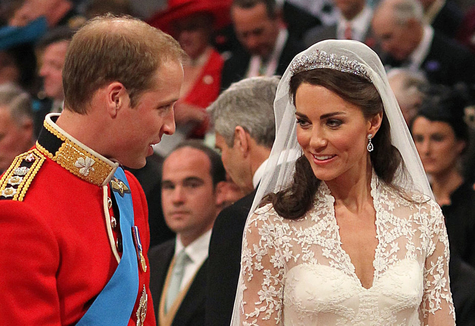 Photo - Prince William and his bride Kate Middleton, right, smile during their wedding service at London's Westminster Abbey, Friday April 29 2011. (AP Photo/Dominic Lipinski, Pool)  ORG XMIT: RWAJP112