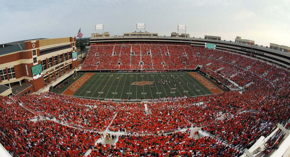 Photo - A record crowd of 59,061 is shown in this photograph taken with a fisheye lens during a college football game between the Oklahoma State University Cowboys (OSU) and the Lamar University Cardinals at Boone Pickens Stadium in Stillwater, Okla., Saturday, Sept. 14, 2013. Photo by Nate Billings, The Oklahoman
