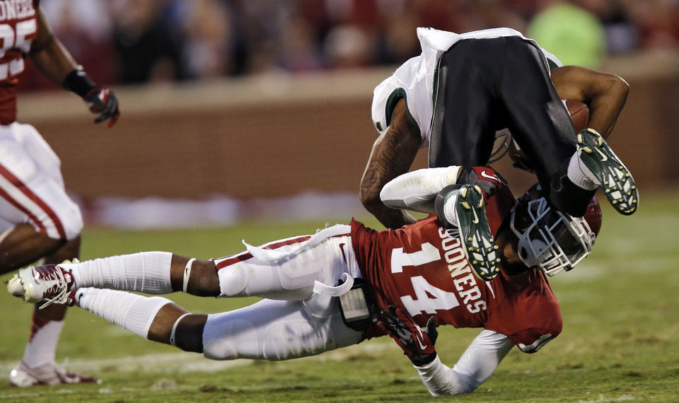 Oklahoma\'s Aaron Colvin (14) brings down Baylor\'s Darryl Stonum (7) during the college football game between the University of Oklahoma Sooners (OU) and Baylor University Bears (BU) at Gaylord Family - Oklahoma Memorial Stadium on Saturday, Nov. 10, 2012, in Norman, Okla. Photo by Chris Landsberger, The Oklahoman