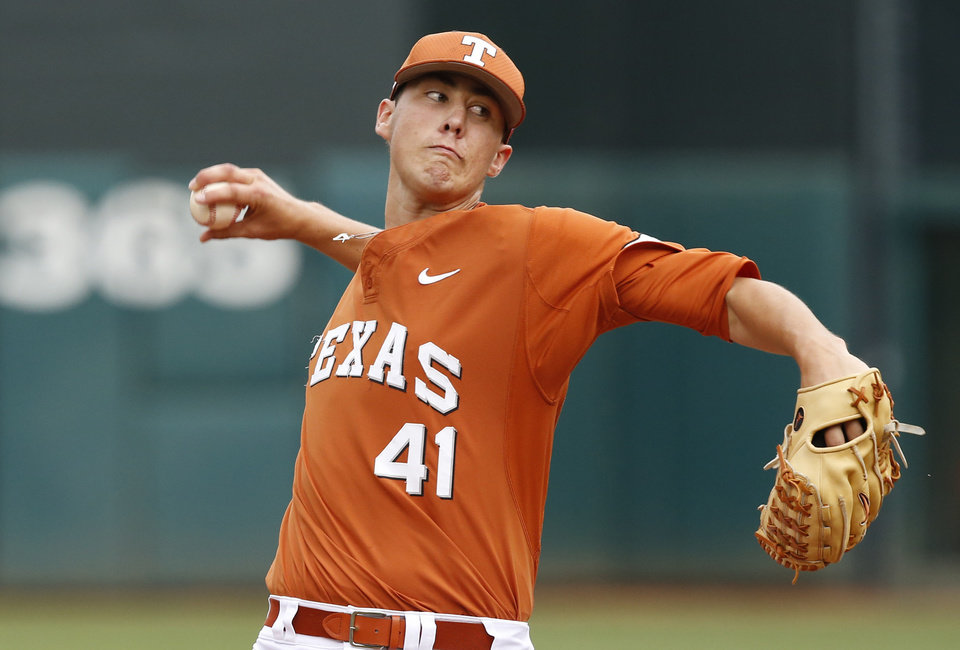 Photo - Texas' Morgan Cooper pitches in the first inning gainst Oklahoma State in the semifinals of the Big 12 Conference NCAA college baseball tournament in Oklahoma City, Saturday, May 24, 2014. AP Photo/Sue Ogrocki)
