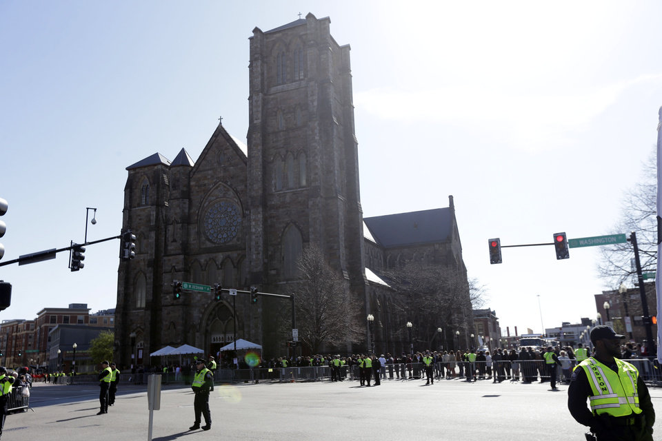 People gather ahead of an interfaith service with President Barack Obama at Cathedral of the Holy Cross, held in the wake of Monday's Boston Marathon explosions, which killed at least three and injured more than 140, Thursday, April 18, 2013, in Boston. (AP Photo/Matt Rourke)