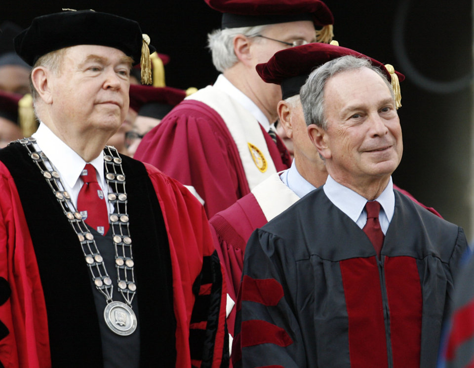 Photo - GRADUATION: OU president David Boren, left, and New York City mayor Michael Bloomberg, the commencement speaker, enter Gaylord Family - Oklahoma Memorial Stadium at the beginning of the commencement ceremony at the University of Oklahoma in Norman, Okla., Friday, May 11, 2007. By Nate Billings, The Oklahoman  ORG XMIT: KOD