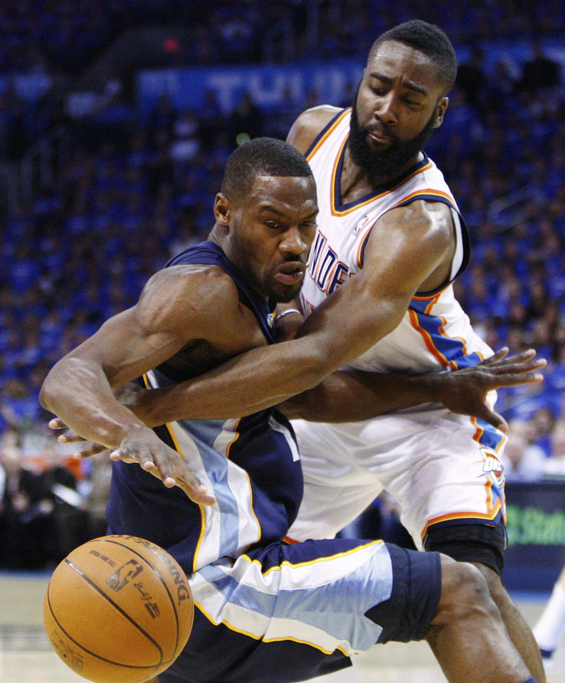 Photo - Oklahoma City Thunder guard James Harden, right, knocks the ball away from Memphis Grizzlies guard Tony Allen in the second quarter of Game 2 of a second-round NBA basketball playoff series in Oklahoma City, Tuesday, May 3, 2011. (AP Photo/Alonzo Adams)