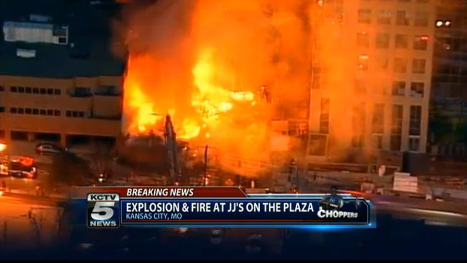 Photo - In this image taken from video from KCTV, firefighters battle a massive fire at Country Club Plaza in Kansas City, Mo. Tuesday, Feb. 19, 2013. A car crashed into a gas main Tuesday evening in an upscale Kansas City shopping district, sparking a massive blaze that engulfed an entire block and caused multiple injuries, police said. (AP Photo/KCTV) MANDATORY CREDIT: KCTV