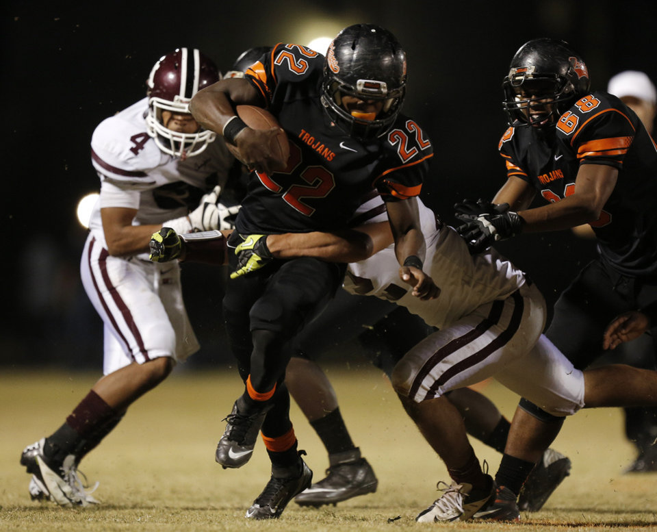 Douglass\'s Dalton Thompson (22) runs the ball during a high school football game between Douglass and Ada at Moses F. Miller Stadium in Oklahoma City, Friday, Nov. 2, 2012. Photo by Garett Fisbeck, The Oklahoman