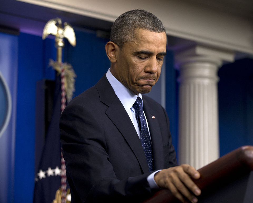 Photo - President Barack Obama pause as he speaks to reporters in the White House briefing room in Washington, Friday, March 1, 2013, following a meeting with congressional leaders regarding the automatic spending cuts. (AP Photo/Carolyn Kaster)