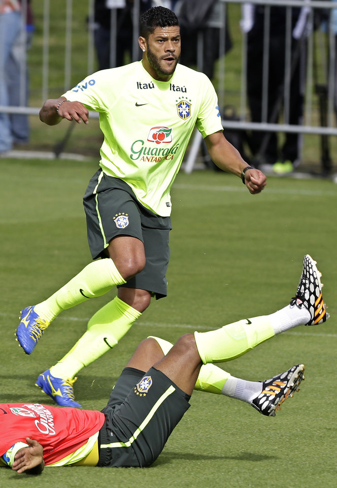 Photo - Brazil's Hulk practices during a training session of the Brazilian national soccer team at the Granja Comary training center in Teresopolis, Brazil, Sunday, June 15, 2014. Brazil plays in group A of the 2014 soccer World Cup. (AP Photo/Andre Penner)